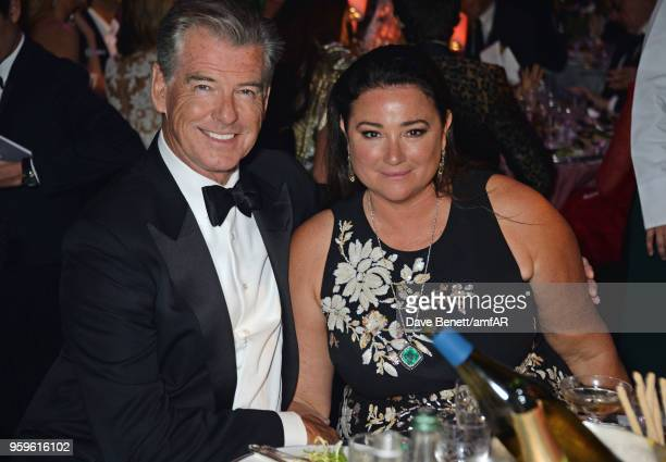 Pierce Brosnan and Keely Shaye Smith attend the amfAR Gala Cannes 2018 dinner at Hotel du CapEdenRoc on May 17 2018 in Cap d'Antibes France