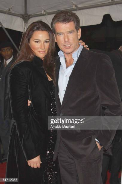 Pierce Brosnan and wife Keely Shaye Smith arrive at the premiere of After The Sunset at the Ziegfeld Theater November 9 2004 in New York City
