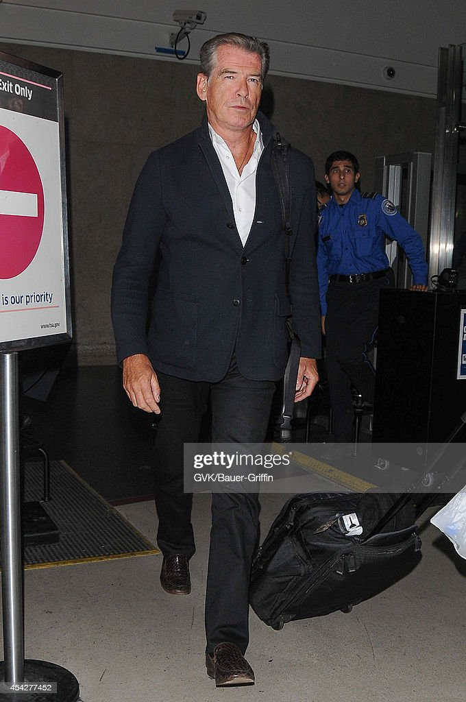 Pierce Brosnan is seen at LAX on August 27, 2014 in Los Angeles, California.