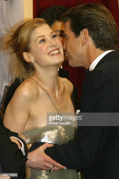 Pierce Brosnan who plays James Bond kisses costar Rosamund Pike at the World Premiere of the James Bond film 'Die Another Day' at the Royal Albert...