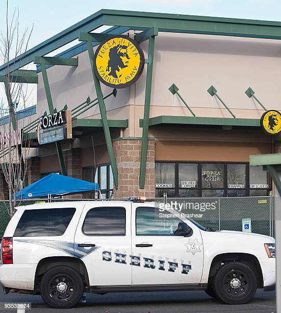 Pierce County Sheriff's Department vehicle sits outside of the Forza Coffee Company shop December 1 2009 near Lakewood Washington The company has...