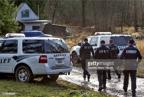 Pierce County Sheriff's deputies investigate the shooting of Deputy Kent Mundell and Sgt Nicholas Hausner on Tuesday December 22 in Pierce County...