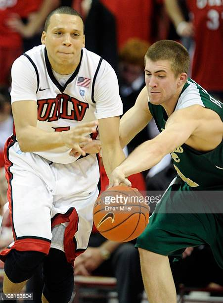 Pierce Hornung of the Colorado State Rams goes for a steal and fouls Derrick Jasper of the UNLV Rebels during their game at the Thomas Mack Center...