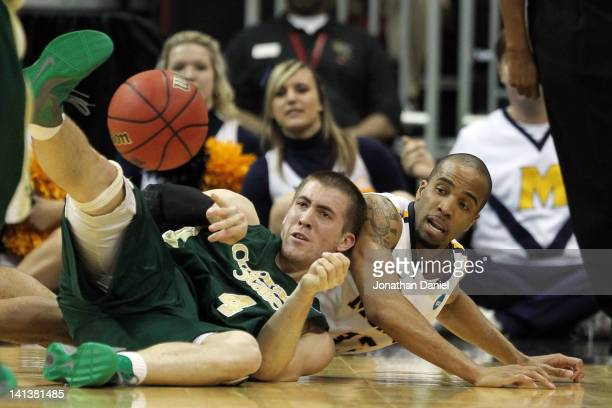 Pierce Hornung of the Colorado State Rams passes the ball while lying on the court against Jewuan Long of the Murray State Racers during the second...