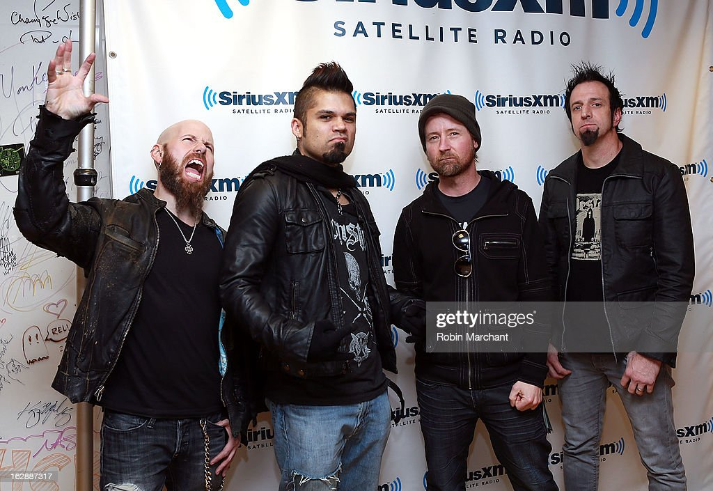 C.J. Pierce, Jasen Moreno, Stevie Benton and Mike Luce of Drowning Pool at SiriusXM Studios on February 28, 2013 in New York City.