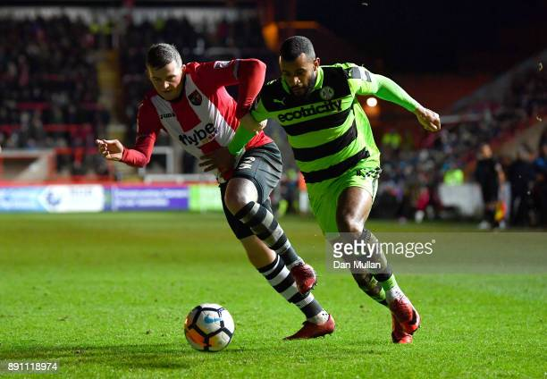 Pierce Sweeney of Exeter City and Daniel Wishart of Forest Green Rovers during the Emirates FA Cup Second Round Replay between Exeter City and Forest...