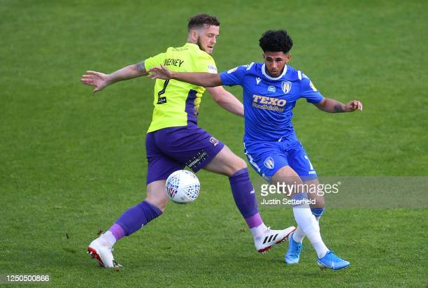 Pierce Sweeney of Exeter City battles for possession with Courtney Senior of Colchester United during the Sky Bet League Two Play Off Semi-final 1st...