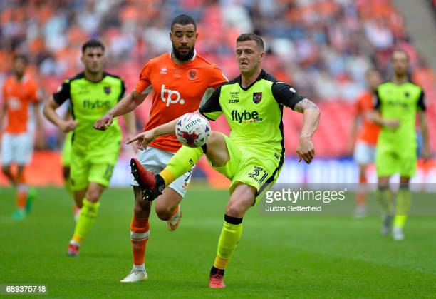 Pierce Sweeney of Exeter City clears from Kyle Vassell of Blackpool during the Sky Bet League Two Playoff Final between Blackpool and Exeter City at...