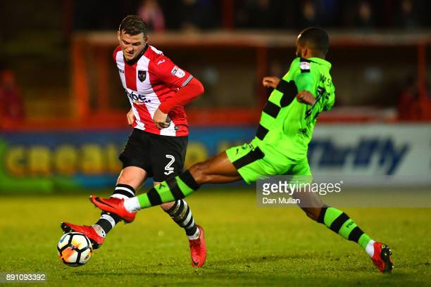 Pierce Sweeney of Exeter City is challenged by Daniel Wishart of Forest Green Rovers during the Emirates FA Cup Second Round Replay between Exeter...