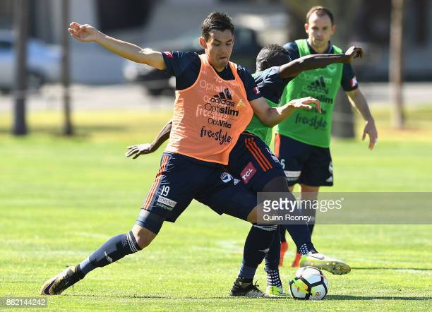 Pierce Waring and Jason Geria of the Victory compete for the ball during a Melbourne Victory ALeague training session at Gosch's Paddock on October...