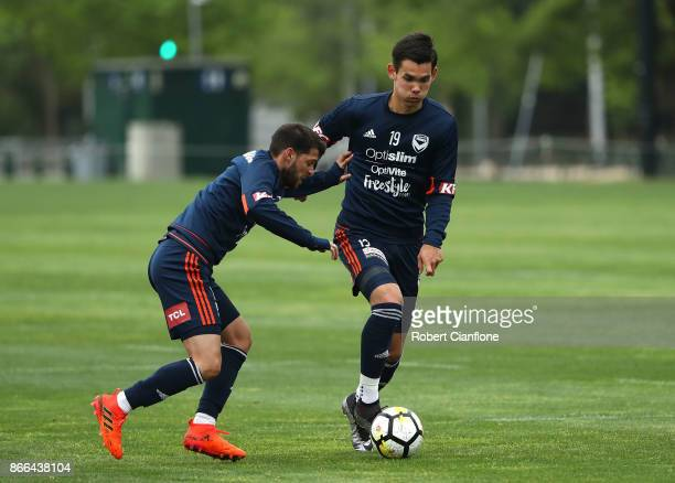 Pierce Waring of the Victory is challenged by Matias Sanchez of the Victory during a Melbourne Victory ALeague training session at Gosch's Paddock on...