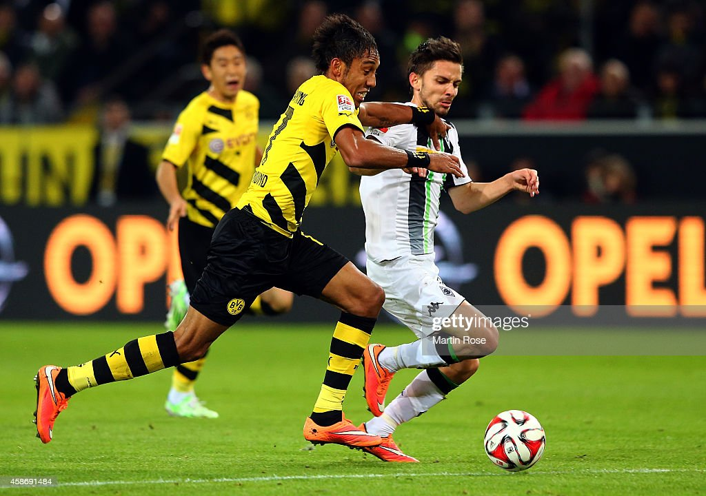 Piere Emrick Aubameyang (L) of Dortmund and Julian Korb of Gladbach battles for the ball during the Bundesliga match between Borussia Dortmund and Borussia moenchengladbach at Signal Iduna Park on November 9, 2014 in Dortmund, Germany.