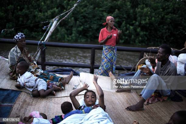 Pieretto Kololo age 27 sing church songs during an early morning church service on a boat with destination Kinshasa on April 1 2006 in Bokondo Congo...