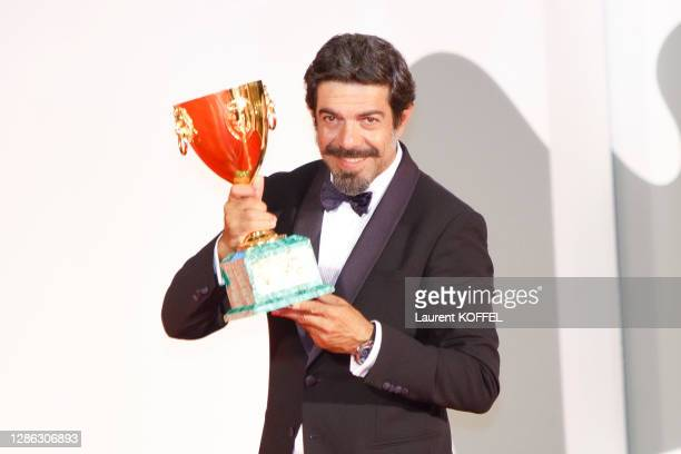 Pierfrancesco Favino poses with the Coppa Volpi for Best Actor during the winners photocall at the 77th Venice Film Festival on September 12, 2020 in...