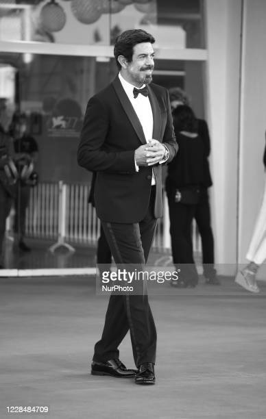 Image was converted to black and white) Pierfrancesco Favino walks the red carpet ahead of closing ceremony at the 77th Venice Film Festival on...