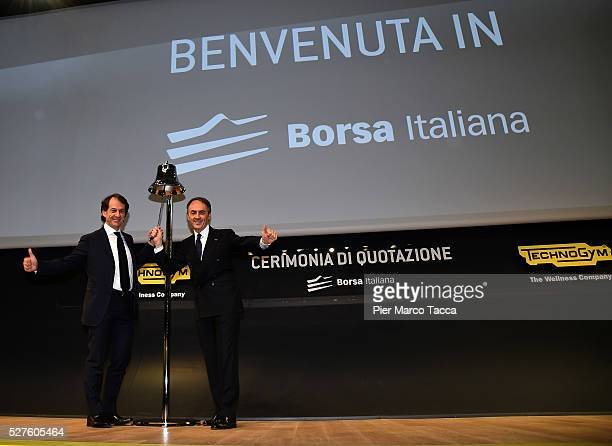 Pierluigi Alessandri and Nerio Alessandri sound the bell of the beginning of the listing on the Milan stock exchange during the Technogym Listing...