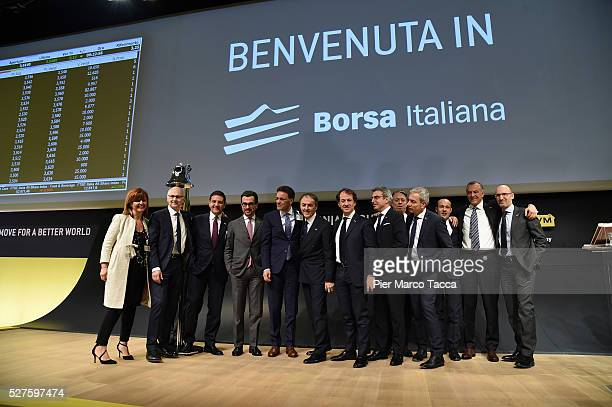 Pierluigi Alessandri and President and founder of Technogym Nerio Alessandri pose with the staff during the Technogym Listing Ceremony at Palazzo...