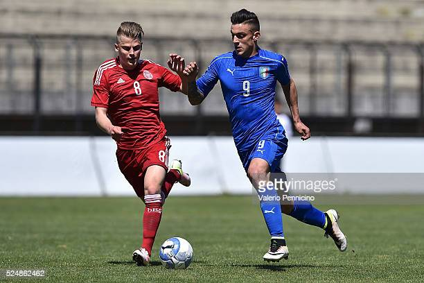Pierluigi Cappelluzzo of Italy U20 is challenged by Mathias Jensen of Denmark U20 during the match between Italy U20 and Denmark U20 on April 27 2016...