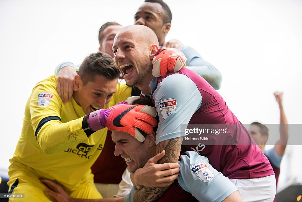 Pierluigi Gollini and Alan Hutton of Aston Villa celebrates with Gary Gardner after he scores during the Sky Bet Championship match between Birmingham City and Aston Villa at St Andrews Stadium on October 30, 2016 in Birmingham, England.