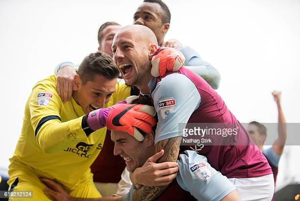 Pierluigi Gollini and Alan Hutton of Aston Villa celebrates with Gary Gardner after he scores during the Sky Bet Championship match between...