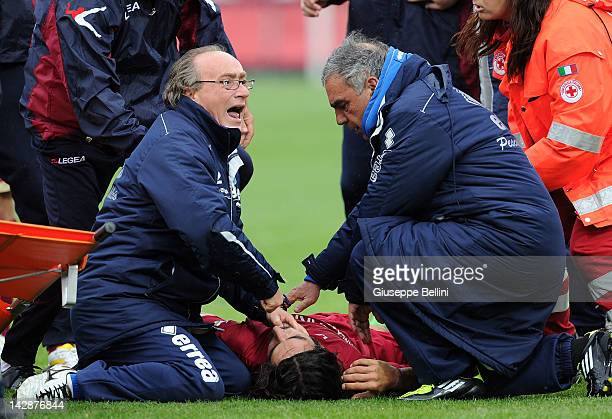 Piermario Morosini of Livorno receives treatment after suddenly collapsing during the Serie B match between Pescara Calcio and AS Livorno at...