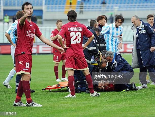 Piermario Morosoni of Livorno receives treatment after suddenly collapsing during the Serie B match between Pescara Calcio and AS Livorno at...