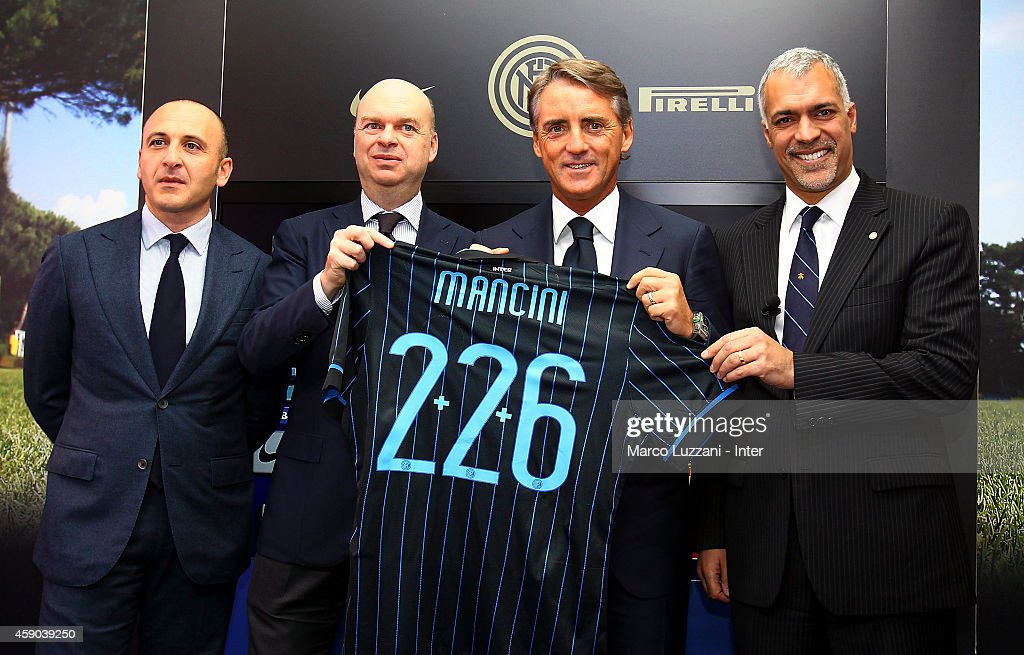 Piero Ausilio, Marco Fassone, new coach of FC Internazionale Milano Roberto Mancini and Michael Bolingbroke during a press conference at the club's training ground on November 15, 2014 in Appiano Gentile Como, Italy.