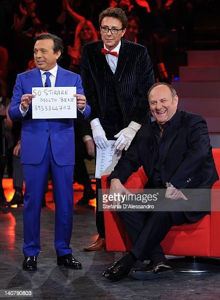 Piero Chiambretti and Gerry Scotti attend 'Chiambretti Wednesday Show' Italian TV Show on March 6 2012 in Milan Italy