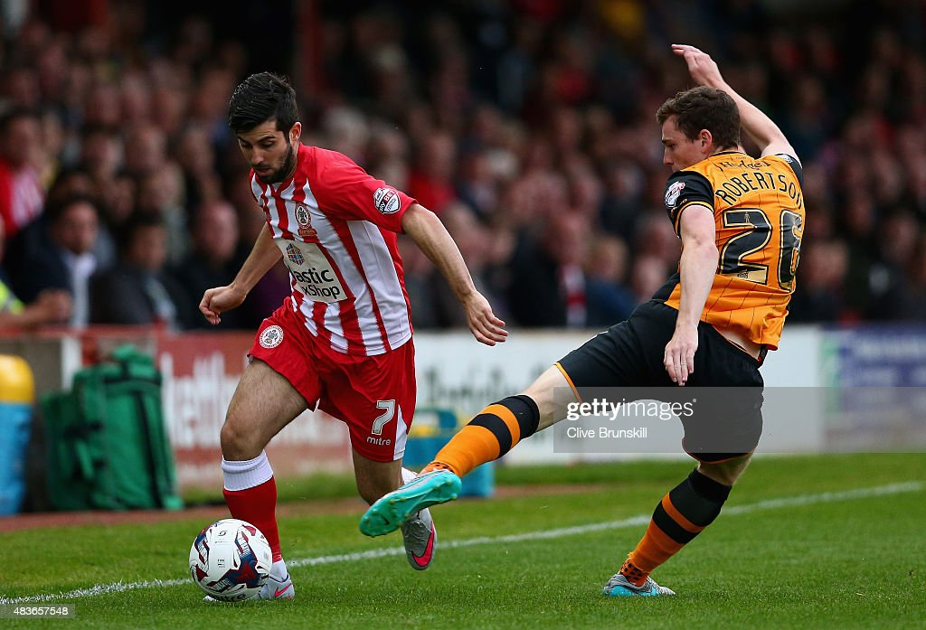 Piero Mingoia of Accrington Stanley in action with Andy Robertson of Hull City during the Capital One Cup First Round match between Accrington Stanley and Hull City at Wham Stadium on August 11, 2015 in Accrington, England.