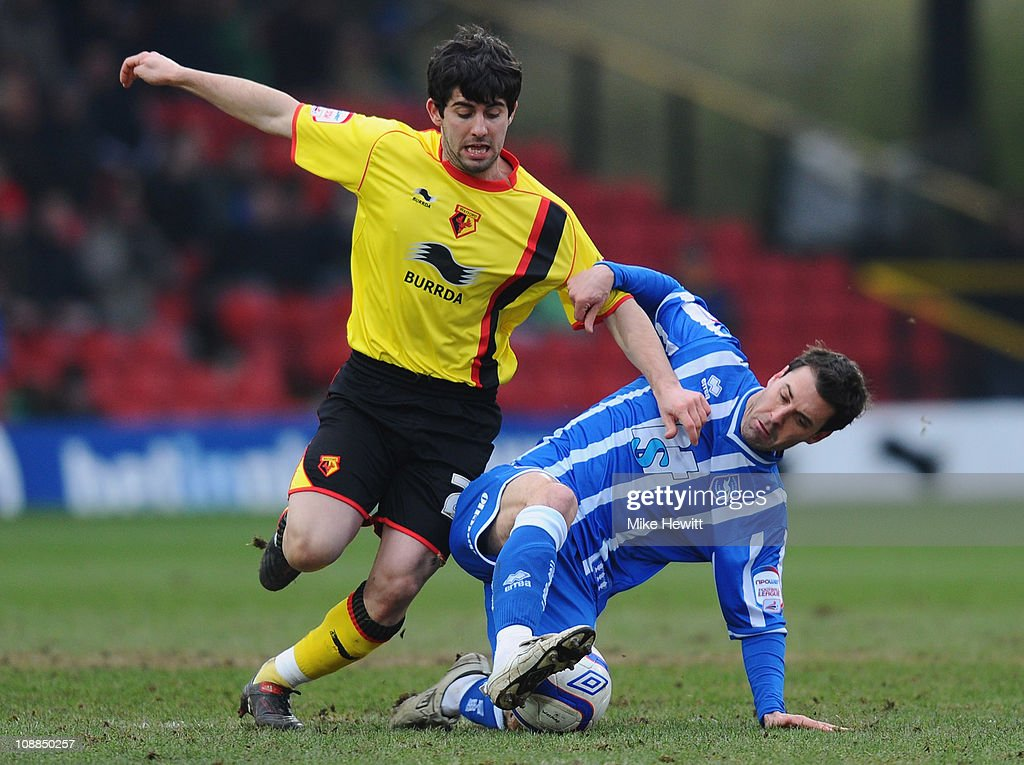 Piero Mingoia of Watford is challenged by Matt Sparrow of Brighton during the FA Cup Sponsored by E.ON 4th Round match between Watford and Brighton & Hove Albion at Vicarage Road on January 29, 2011 in Watford, England.
