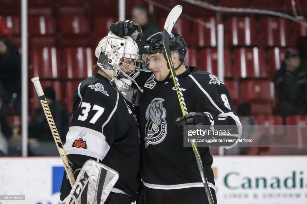Pier-Olivier Lacombe #8 of the Gatineau Olympiques celebrates with teammate Tristan Berube #37 their 2-1 win over the Saint John Sea Dogs on December 1, 2017 at Robert Guertin Arena in Gatineau, Quebec, Canada.