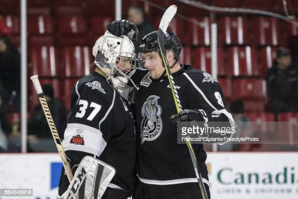 PierOlivier Lacombe of the Gatineau Olympiques celebrates with teammate Tristan Berube their 21 win over the Saint John Sea Dogs on December 1 2017...