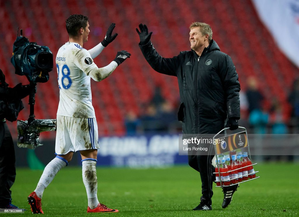 Pieros Sotiriou of FC Copenhagen and Anders Storskov, physical coach of FC Copenhagen celebrate after the UEFA Europa League match between FC Copenhagen and FC Sheriff at Telia Parken Stadium on December 7, 2017 in Copenhagen, Denmark.