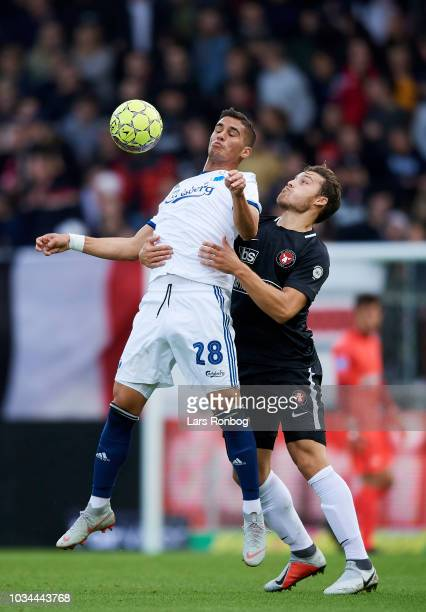 Pieros Sotiriou of FC Copenhagen and Erik Sviatchenko of FC Midtjylland compete for the ball during the Danish Superliga match between FC Midtjylland...
