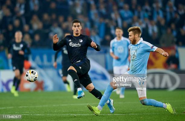 Pieros Sotiriou of FC Copenhagen and Rasmus Bengtsson of Malmo FF compete for the ball during the UEFA Europa League match between Malmo FF and FC...