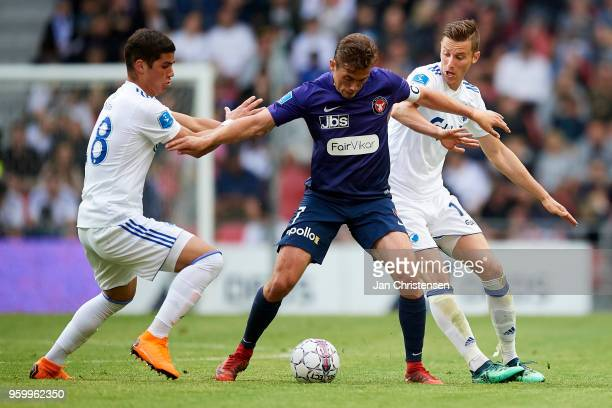Pieros Sotiriou of FC Copenhagen Jakob Poulsen of FC Midtjylland and Ján Gregus of FC Copenhagen compete for the ball during the Danish Alka...