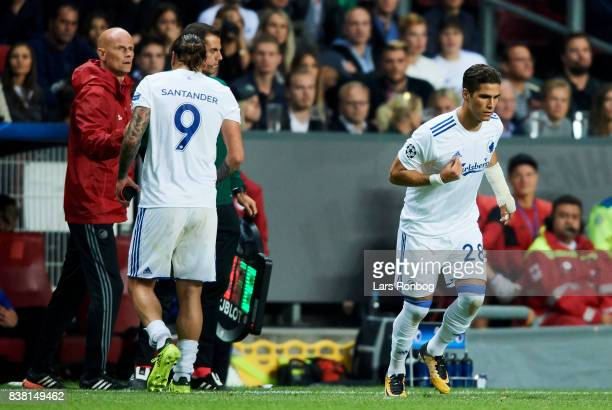 Pieros Sotiriou of FC Copenhagen runs on to the pitch instead of Federico Santander of FC Copenhagen who shake hands with Stale Solbakken head coach...