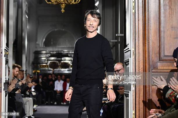 Pierpaolo Piccioli acknowledges applause on the runway during the Valentino Menswear Fall/Winter 20182019 show as part of Paris Fashion Week on...