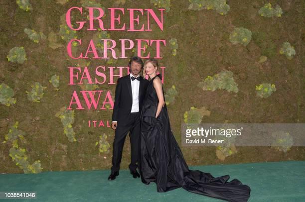 Pierpaolo Piccioli and Alba Rohrwacher, wearing Valentino, attend The Green Carpet Fashion Awards Italia 2018 at Teatro Alla Scala on September 23,...
