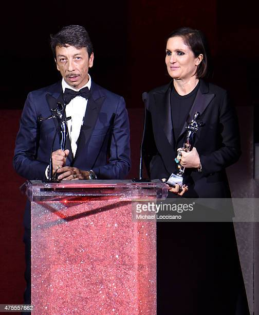 Pierpaolo Piccioli and Maria Grazia Chiuri accept the International Award onstage at the 2015 CFDA Fashion Awards at Alice Tully Hall at Lincoln...