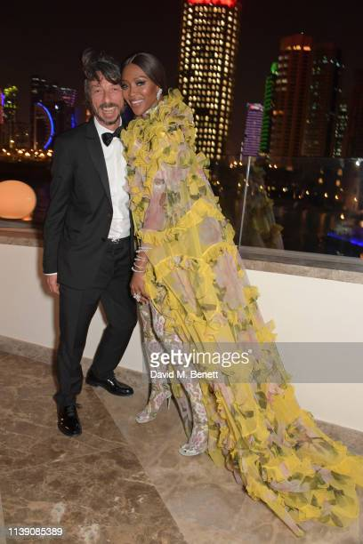 Pierpaolo Piccioli and Naomi Campbell attend the Fashion Trust Arabia Prize awards ceremony on March 28 2019 in Doha Qatar