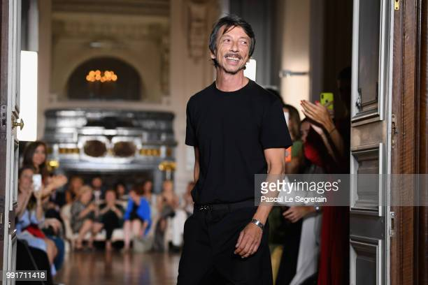 Pierpaolo Piccioli is appluaded on the runway during the Valentino Haute Couture Fall Winter 2018/2019 show as part of Paris Fashion Week on July 4...
