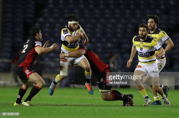 Pierre Aguillon of La Rochelle drives forward during The European Challenge Cup match between Edinburgh and La Rochelle at Murrayfield Stadium on...