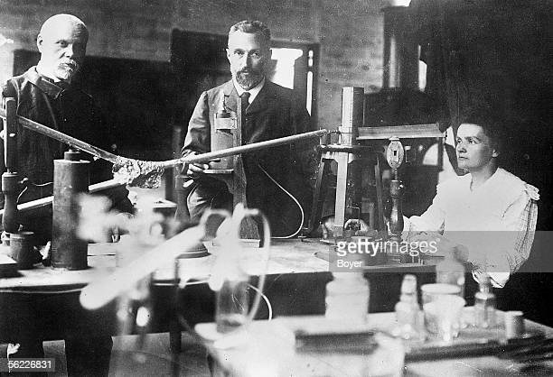 Pierre and Marie Curie French physicists in their laboratory of the rue d'Ulm in 1905 On the left their colleague Andre Debierne