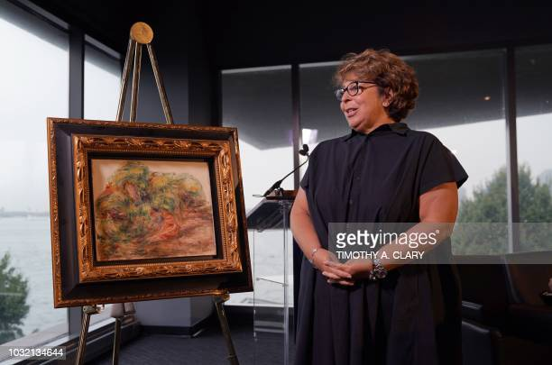 A Pierre Auguste Renoir painting Femmes Dans Un Jardinstolen by the Nazis was unveiled by the US Attorney for the Southern District of New York and...