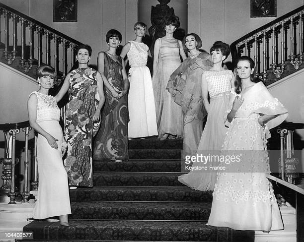 Pierre BALMAIN's models posed in the staircase of London's Fishmonger Hall before giving a fashion show for the 'Association for Invalid Children' in...