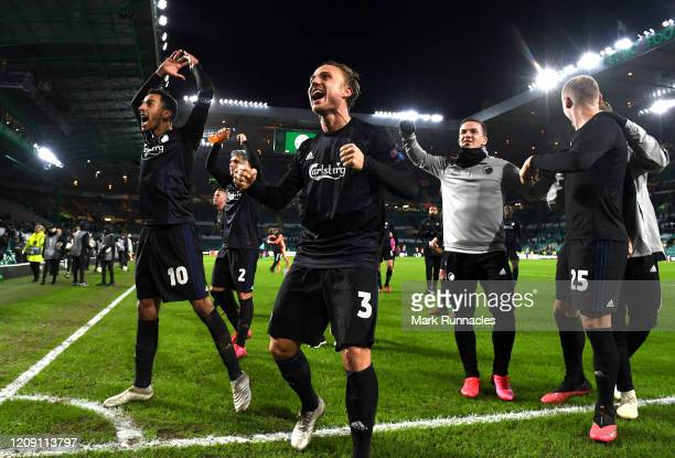 Pierre Bengtsson and team mates of FC Copenhagen celebrate victory during the UEFA Europa League round of 32 second leg match between Celtic FC and...