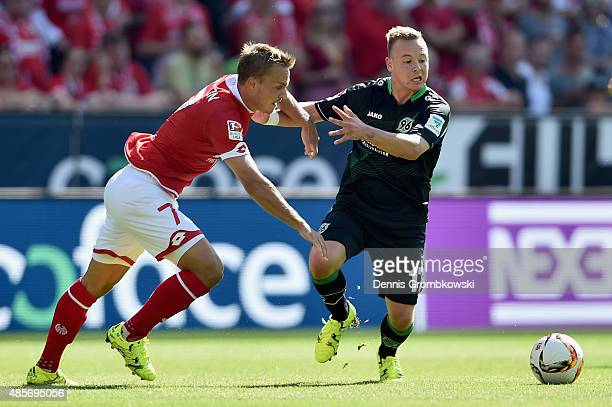 Pierre Bengtsson of 1 FSV Mainz 05 challenges Uffe Bech of Hannover 96 during the Bundesliga match between 1 FSV Mainz 05 and Hannover 96 at Coface...