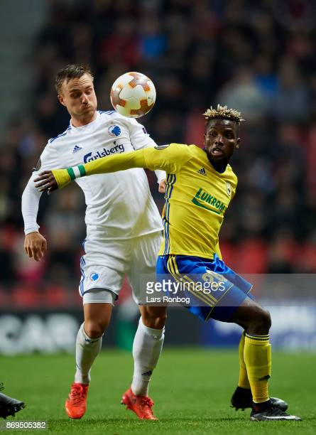 Pierre Bengtsson of FC Copenhagen and Ubong Ekpai of FC Zlin compete for the ball during the UEFA Europa League match between FC Copenhagen and FC...