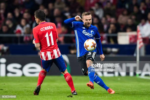 Pierre Bengtsson of FC Copenhague fights for the ball with Angel Correa of Atletico de Madrid during the UEFA Europa League 201718 Round of 32 match...